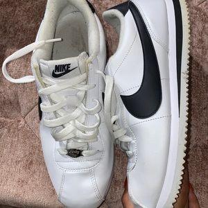 White and Black Nike Cortez